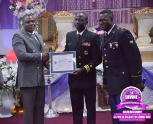 Dr. Kofi Adonteng Boateng being presented with his award by Lt. Commander Alex Amankwaah of the US Navy.