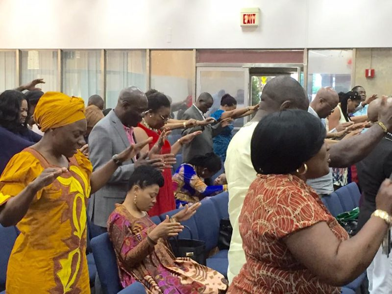 The congregation at Amazing Love Church Ministry Int'l in a sobering and solemn mood for prayers.