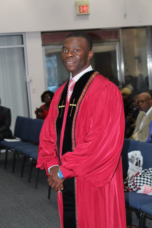 Assistant Pastor Jean Paul Ntap gets ready to deliver the sermon this past Sunday.