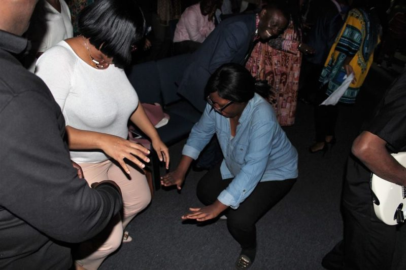 Filled with spirit, the ladies dance to glorify God.