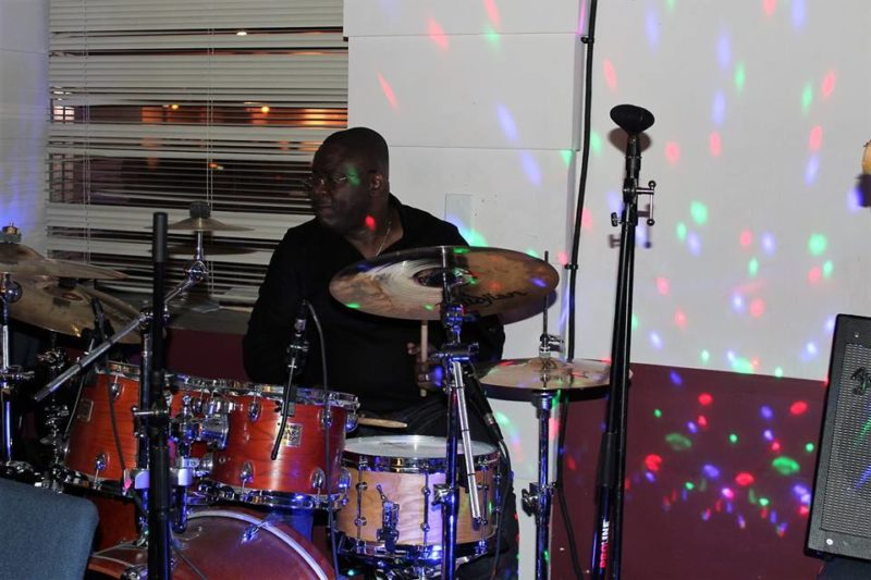 Senior Pastor Georges Ntemi displays his musical skills as he takes over the drums to make the concert a memorable one.
